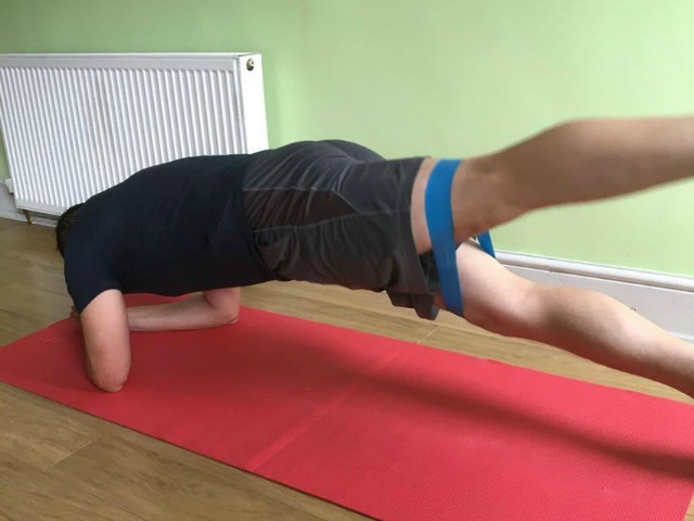plank and glute squeeze using a resistance band